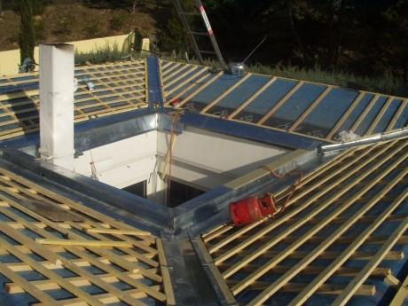 Caniveau et noue en zinc sur une toiture